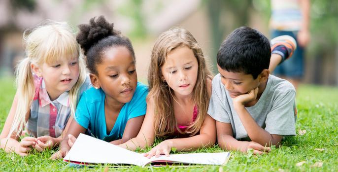 diverse-kids-reading-outside.jpg