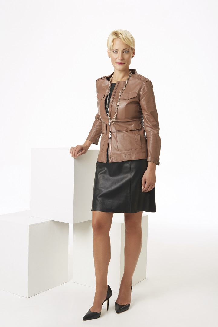 Blush+leather+jacket+and+black+leather+and+suede+dress,+full+length.jpg