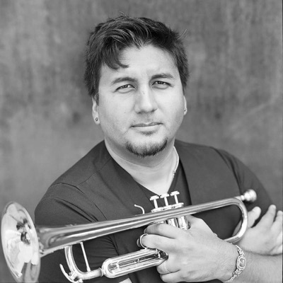 "MIKE RODRIGUEZ / TRUMPET GRAMMY-nominated trumpeter/composer Mike Rodríguez was born in 1979 in Queens, New York. Rodríguez was inspired to pursue music as a career by his father, Roberto Rodríguez, who is a drummer. Rodríguez studied at the New World School of the Arts in Miami, Florida and continued his studies at the University of Miami. After completing two years at the University of Miami, he decided to transfer to the New School in New York where he received his B.A. Rodríguez has performed and toured with Clark Terry, Bobby Watson, Quincy Jones, Joe Lovano, Toshiko Akiyoshi Orchestra, pop icon Jessica Simpson, the Chico O'Farrill Afro Cuban Jazz Orchestra, Arturo O'Farrill and the Afro Latin Jazz Orchestra, and the Jazz at Lincoln Center Orchestra, and is a member of Charlie Haden's Liberation Music Orchestra. Rodríguez has also performed and traveled with Jon Faddis and the Carnegie Hall Jazz Band, Carla Bley Band and Quintet, The Clayton Brothers, Kenny Barron Quintet, Conrad Herwig's Latin Side projects, Harry Connick, Jr., Bob Mintzer, Eddie Palmieri Septet, Herbie Hancock, Chick Corea, and the Smithsonian Jazz Orchestra, among others. Rodríguez recorded on Charlie Haden's 2004 GRAMMY Award-winning album featuring Gonzalo Rubalcaba and Joe Lovano, Land of the Sun. He also recorded on Charlie Haden's Liberation Music Orchestra's 2005 album, Not in Our Name, and is featured on ""America the Beautiful"" and Dvořák's ""Going Home."" In 2008 Rodríguez became a member of the Gonzalo Rubalcaba Quintet and recorded Avatar on the Blue Note label. In 2013 he released his debut solo recording on the Criss Cross label entitled Reverence. Rodríguez and his brother, pianist Robert Rodríguez, have recorded four albums together, including Introducing the Rodríguez Brothers, Conversations, Mood Swing, and their most recent album, Impromptu, which was nominated for a GRAMMY Award for Best Latin Jazz Album. Rodríguez is currently on the faculty at NYU as Professor of Trumpet and travels the globe as a clinician."