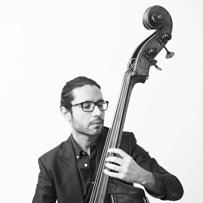 "RICKY RODRIGUEZ / BASS Ricardo ""Ricky"" Rodríguez was born in Ponce, Puerto Rico, where he also started his music studies. He received his Bachelor of Music in Classical Bass performance under the tutelage of professors Federico Silva and Jose García at the Conservatory of Music of Puerto Rico in 2004. Rodríguez moved to New York City to experiment and increase his musical development in a different musical style: Jazz. He took private lessons with two of his bass heroes, Larry Grenadier and Scott Colley. Within a year, Rodríguez began performing with internationally distinguished musicians, including David Sánchez Quartet, Branford Marsalis, Michele Rosewoman, Miguel Zenón Quartet, Adam Rogers, Lionel Loueke, Clarence Penn, Ignacio Berroa Quartet, Dave Samuels, Dave Schnitter, Janis Siegel, Joe Locke, Marlon Simon and the Nagual Spirits, Pedrito Martínez, Mayra Casales, the Rodríguez Brothers, Osmany Paredes Quartet, Papo Vázquez and Pirates Troubadours, Donny McCaslin Trio, Luis Bonilla and Trombonilla, Paoli Mejias, Ricardo Pons and Causa Común, Los Pleneros de la 21, the Samuel Torres Band, Cristos Rafalides and the Manhattan Vibes, Ximo Tebar and the Four Lights, the Chico O'Farrill Afro Cuban Jazz Orchestra, Arturo O'Farrill and the Afro Latin Jazz Orchestra, Michel Camilo Trio, and many others. Since then, Rodríguez has performed with some of the giants in Latin Jazz today. These include performances with legendary jazz icons such as Ray Barretto, Endel Dueño, Giovanni Hidalgo, Jerry González, Chuchito Valdés, Tony Lujan, Erik Figueroa Trio, and Mandy Visoso and his Orchestra, as well as memorable performances with masters such as Branford Marsalis, Danilo Pérez, David Sánchez, and Ignacio Berroa. He is currently touring with Michel Camilo and Trio Latino, David Sánchez Group, Joe Locke Quartet, Ignacio Berroa Quartet, and his own group. His new solo album, Ricky Rodríguez Group Looking Beyond, was released in June 2016 on the Destiny Record Label."
