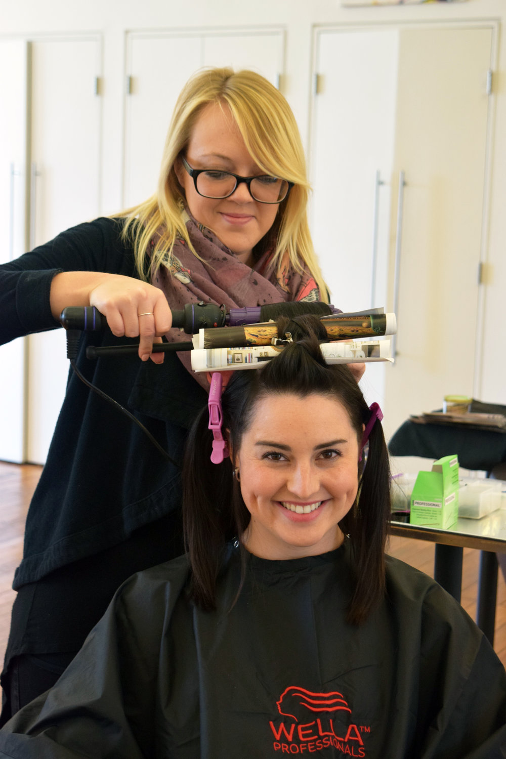 Mandy Asberry creates curly hair styles  in downtown Raleigh at Alter EGO Hair Salon and Blow Dry Bar.