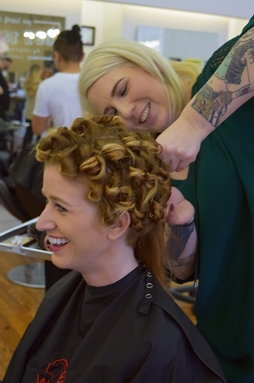 Meghann Holland pins curls for couture styles at Alter EGO Hair Salon in Raleigh.