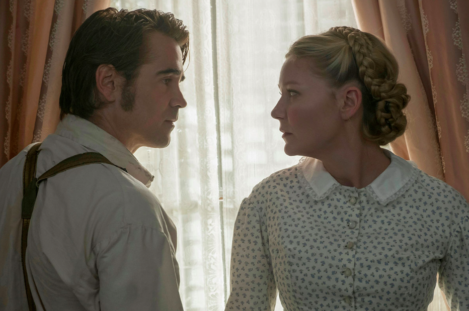Colin Farrell is as swept up in Kirsten's braided updo as we are.