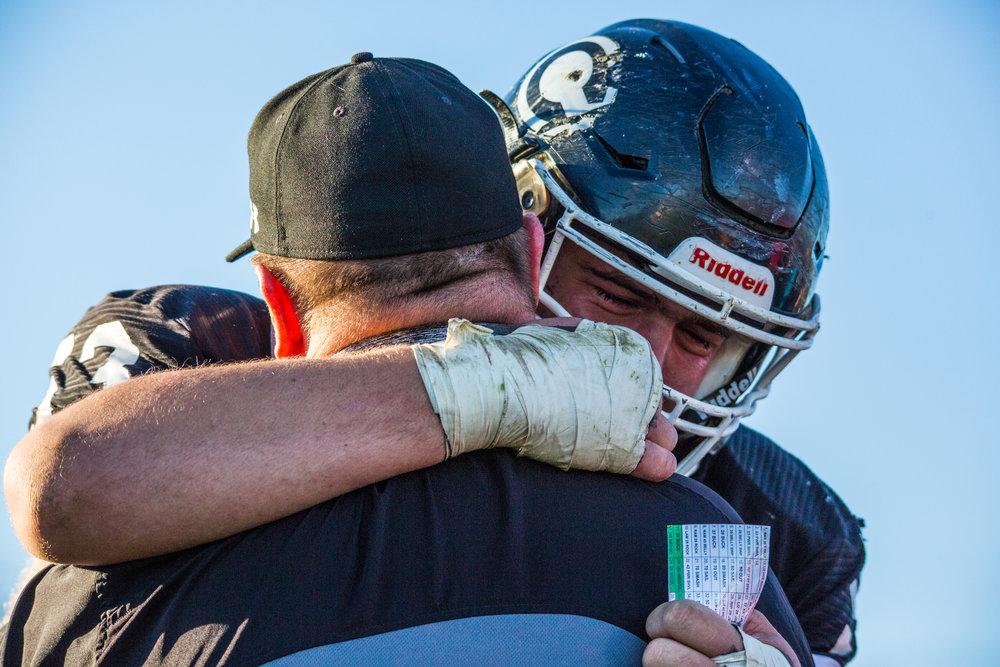 Centralia High School Football Coach Erle Bennett hugs senior Sam Hasekamp after losing a playoff game at Centralia High School on Saturday, Nov. 12, 2016.