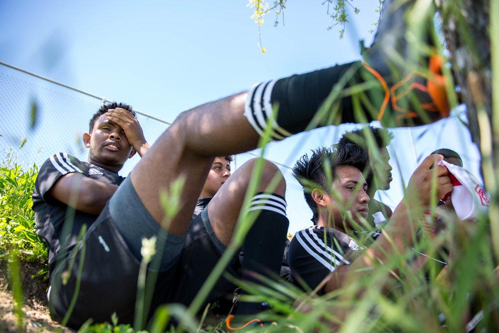 Originally from Eritrea, Africa, Oakland International High School senior Merhawi Beyene rests after a soccer game on Saturday, April, 14, 2018.