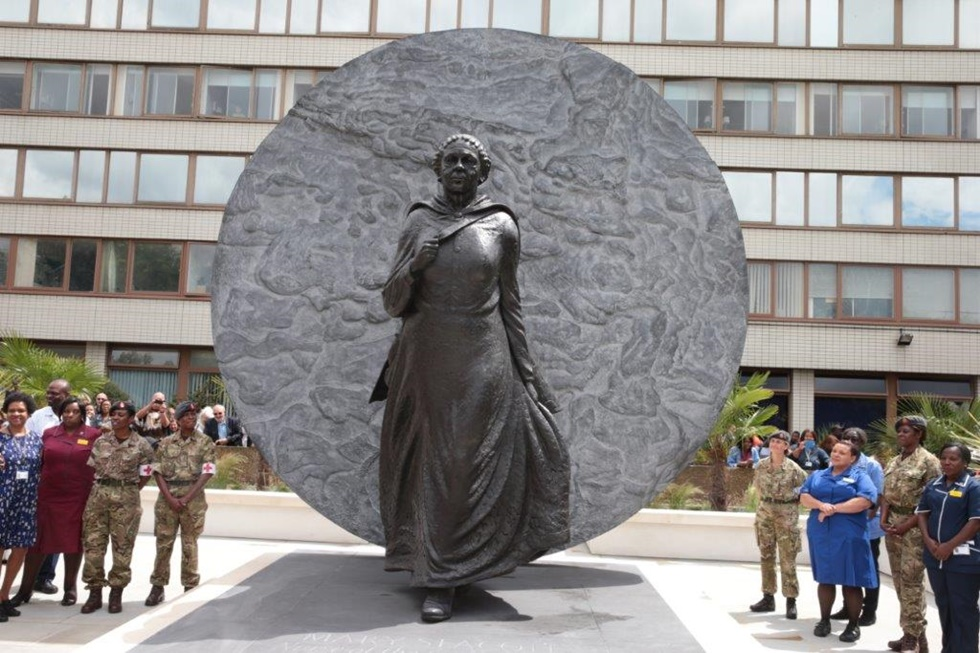 Seacole's statue is lit from the front, casting her shadow on to the disc, signifying fallibility, humanity and mortality. (Amy Fleming, The Guardian, 21st June, 2016.)