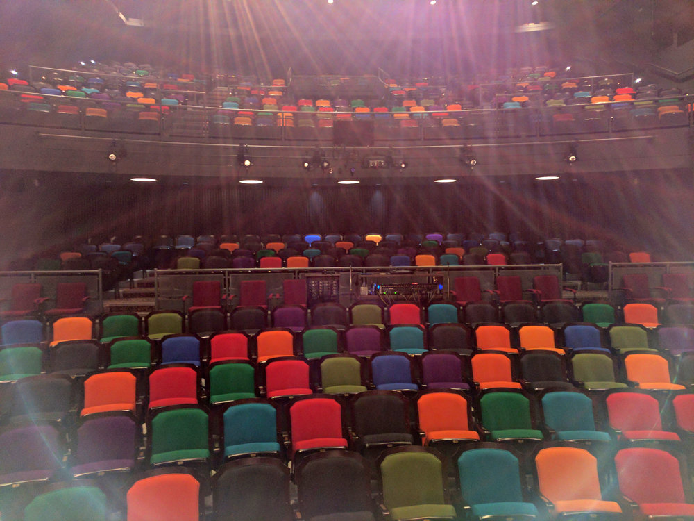 The Lebowsky Center's colorful seats, as we waited for hundreds of children to arrive.