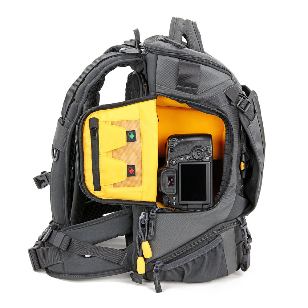 - The side access zip flap reveals the main body of the bag with quick access to your camera and fixed lens, if that's how you wish to use it, the flap has a little double pocket for memory cards.