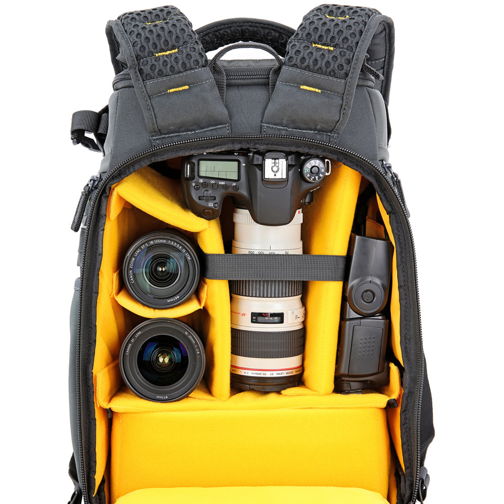 - The rear access reveals all of the main section compartmentalized into space for camera lenses, flash etc.