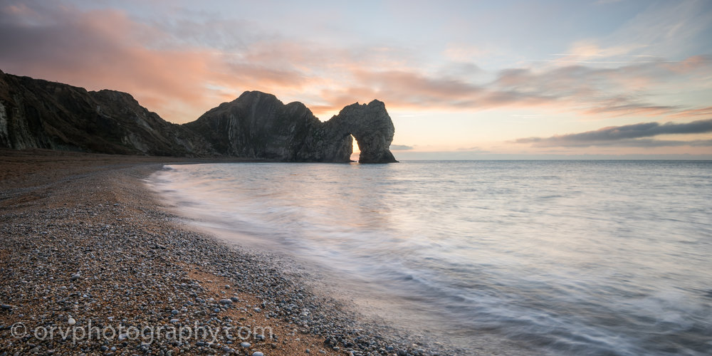 Sunrise at Durdle Door on the Jurassic Coast in Dorset, England