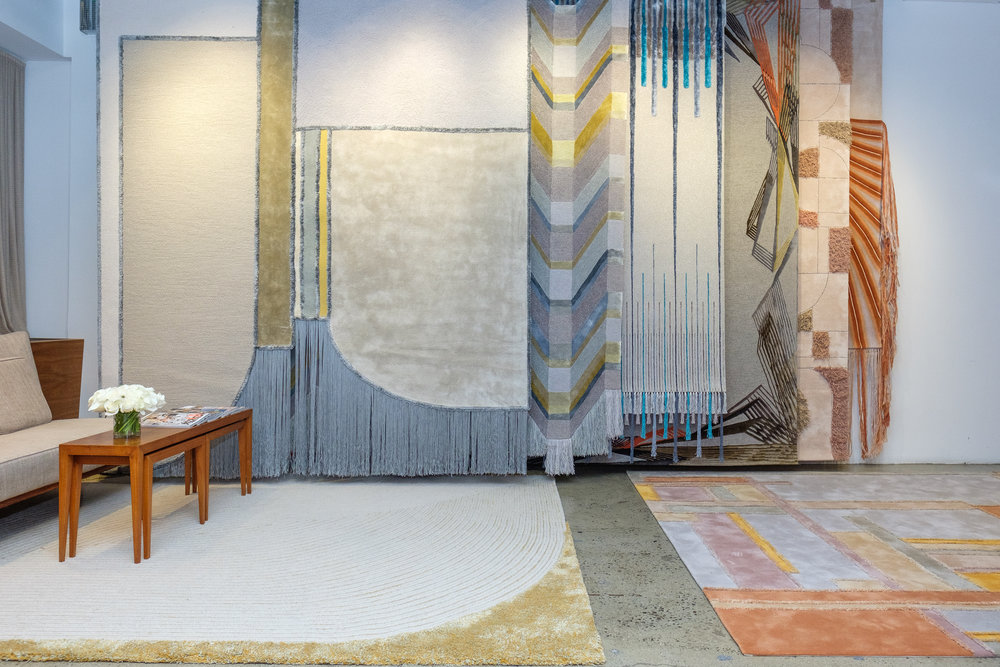 Five of the rugs are designed to be hung as tapestries — but they also have floor-ready versions