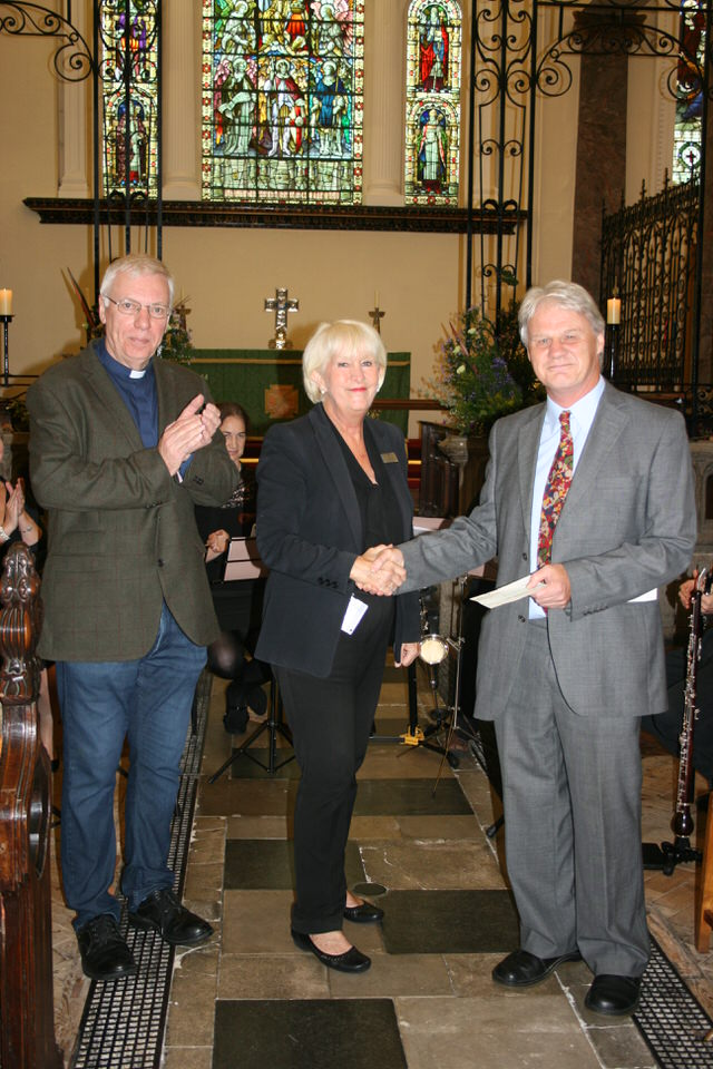 Jane Williams from The Greenbank Hotel hands over a cheque to Michael White, organiser of the concert series.