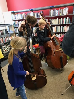 Brother and sister Erin aged 6 and Rowan aged 8 from Truro playing the double bass: