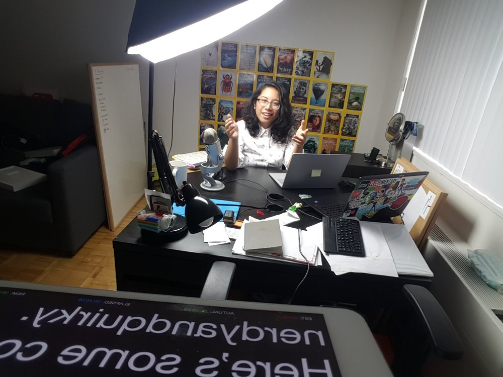 Sabrina Cruz at her editing desk with her sweet iPad teleprompter setup!