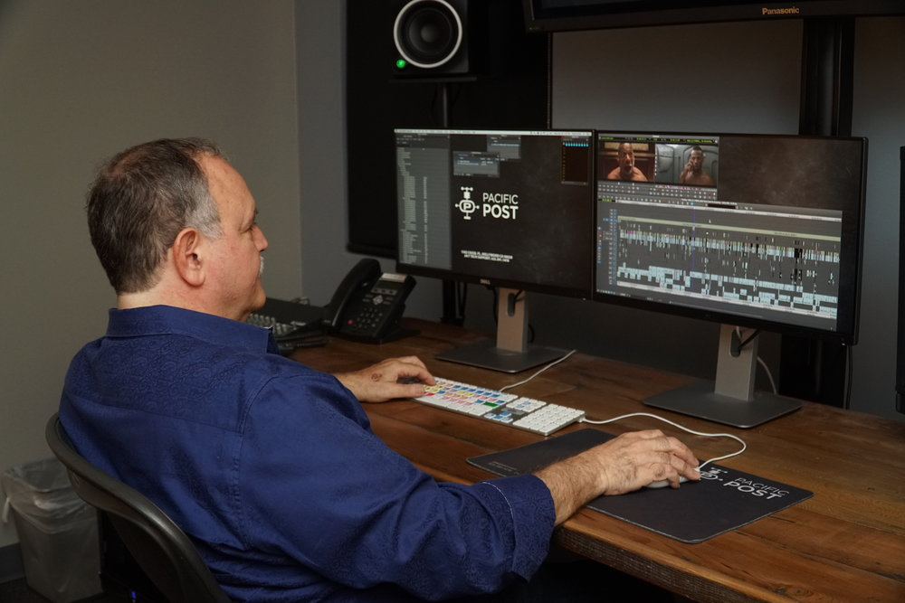 Lawrence Jordan editing with Avid Media Composer and a  LogicKeyboard.