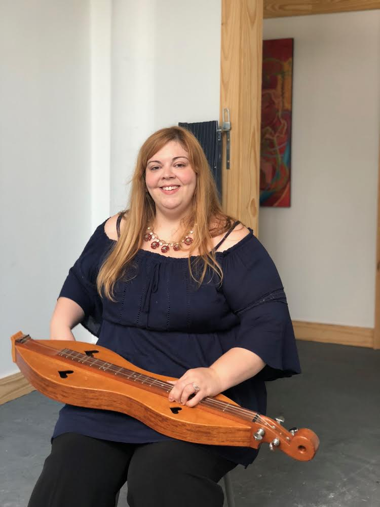 About your artisan instructor, Melissa Buck: - Melissa Buck is a skilled bluegrass/Americana musician. She has experience in teaching courses in Appalachian Mountain Dulcimer,bluegrass band, guitar, vocals, songwriting, and harmony singing. Melissa also taught music, art, and theater through a music grant for the arts at the Boys and Girls Club. She received an International Bluegrass Music Award for Recorded Event of the Year in 2009 for Bluegrass Bouquet along with a few other ladies on the track