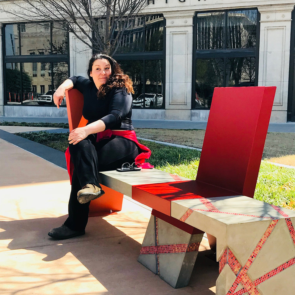 "Beatriz Mayorca sits on her project ""Nurture"" which was finished in 2018 and located in Hightower Park, OKC."