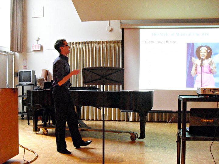 Jordan Scholl   at the University of Guelph presenting a lecture demonstration on how the anatomy of the voice changes to support healthy singing in a variety of different styles.