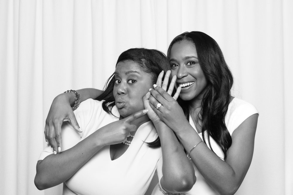 Nancy-and-vanessa-showing-engagement-ring-bridal-shower-black-&-white-photo-booth.jpg