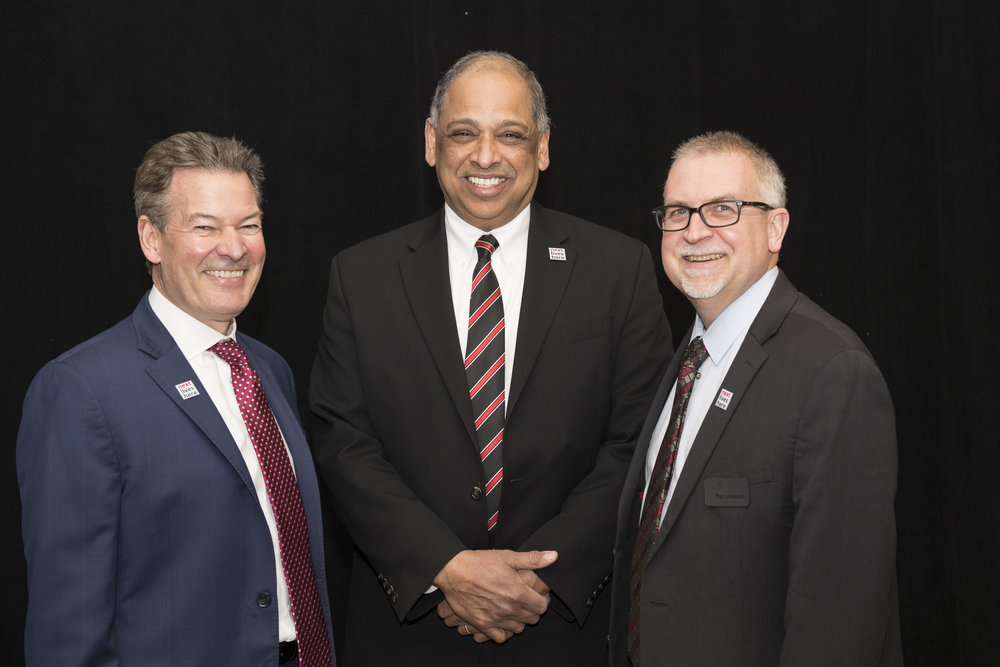 UC President and Uptown Consortium Board Chairman Neville Pinto, PhD, (Center) shares a laugh alongside event speakers and organizers Chief Innovation Officer at UC David Adams, MSE (left) and UC Vice President for Research Patrick Limbach, PhD (right).