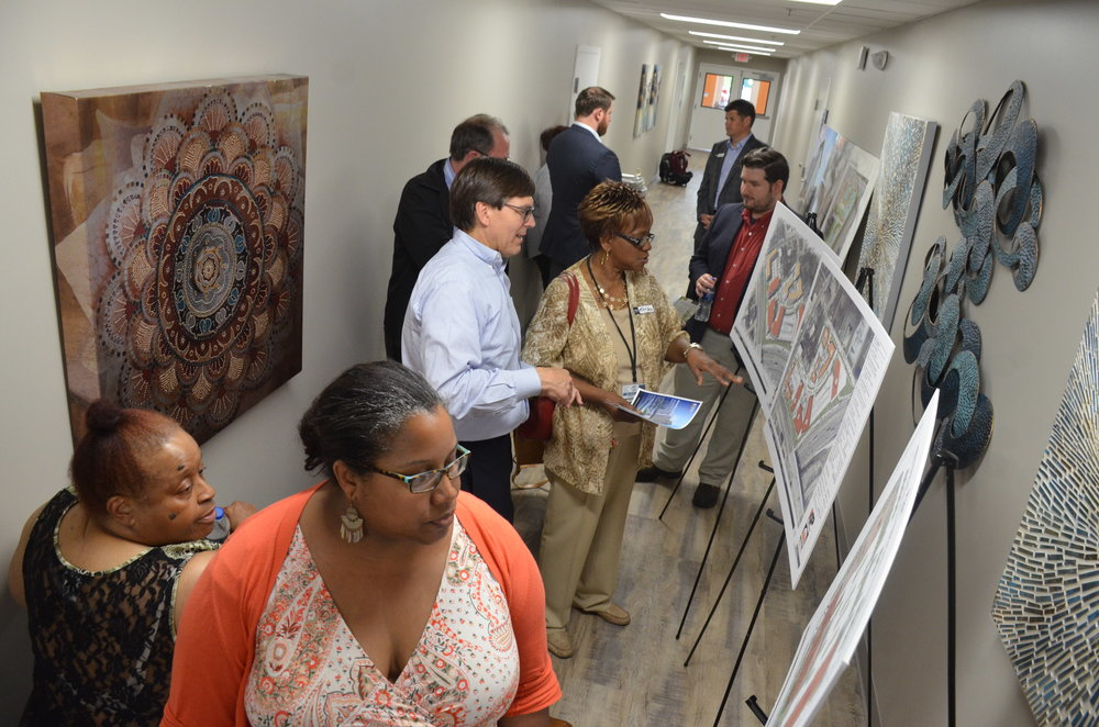 Uptown Cincinnati residents and developers review renderings of forthcoming UIC developments.