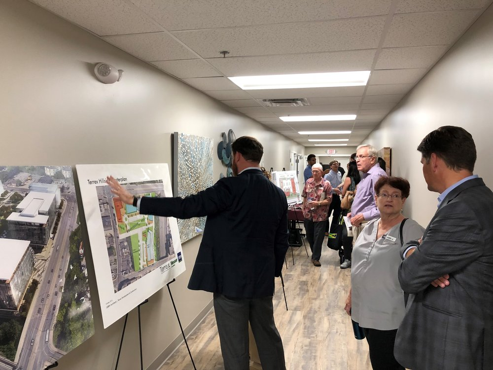 Peter Horton, Principal and Co-Founder of Terrex, chats with guests reviewing the site plan and design rendering for Terrex and Messer's Uptown Gateway development, located in the southeast quadrant of the Corridor.