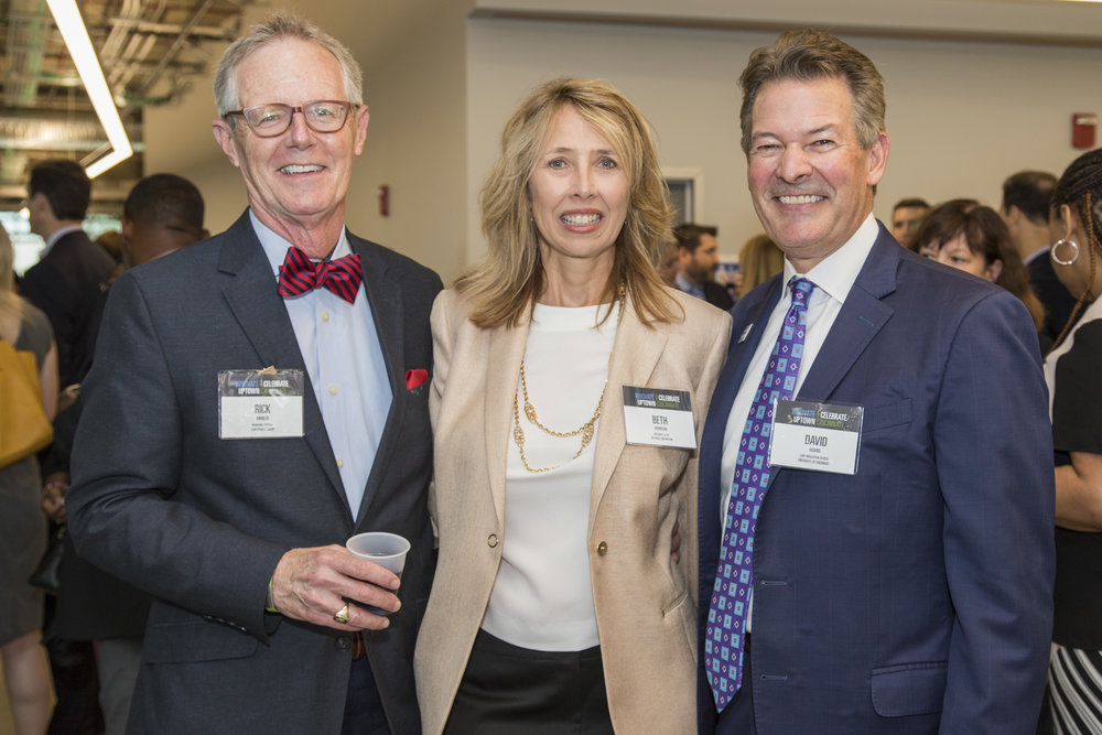 Uptown Consortium, Inc. (UCI) President and CEO Beth Robinson poses with Northpointe managing partner Rick Kimbler (left) and University of Cincinnati chief innovation officer David Adams (right).