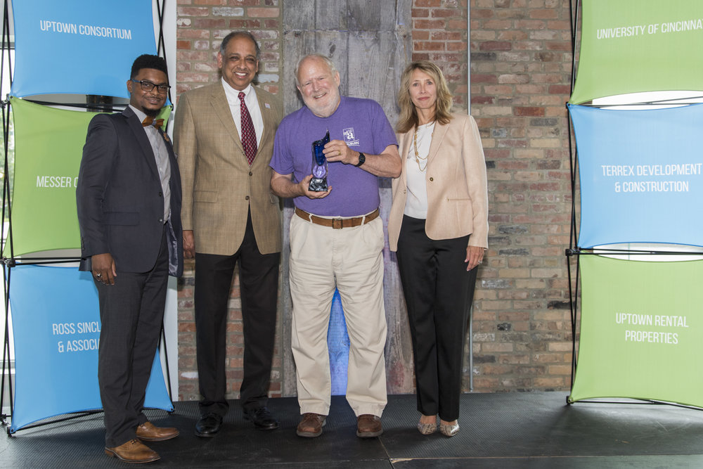 Mt. Auburn Community Council's Steve Gibbs receives the award for Community Champion. Gibbs is joined by CCHMC program manager of community relations John Scott (left), Neville Pinto, PhD (UC) and Beth Robinson (UCI).