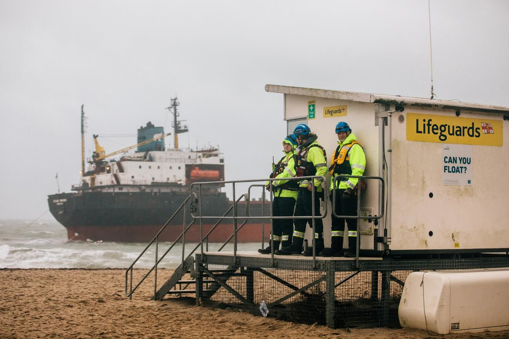 Coastguard Rescue workers on call as a rescue operation is carried out to refloat a Russian cargo ship which was grounded at Gyllyngvase Beach on Tuesday morning. Falmouth, Cornwall, UK. 18th Dec 2018.