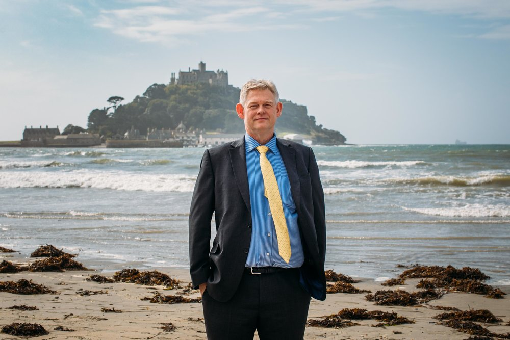 Billy Marshall, headteacher of Humphry Davy School, who protested against education funding cuts, in front of St Michael's Mount. Marazion, Cornwall, UK. Tuesday 18th Sept 2018.