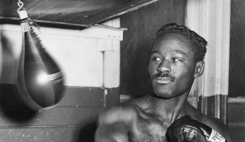 NEW YORK, NY - DECEMBER 5, 1948: Ezzard Charles works over the light bag during training at the Uptown Gym, in New York, NY on December 5, 1948. (Photo by The Stanley Weston Archive/Getty Images)