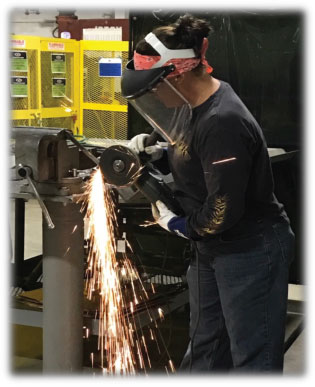 Jaime Magee performing work at Jackson Fabrication Shop