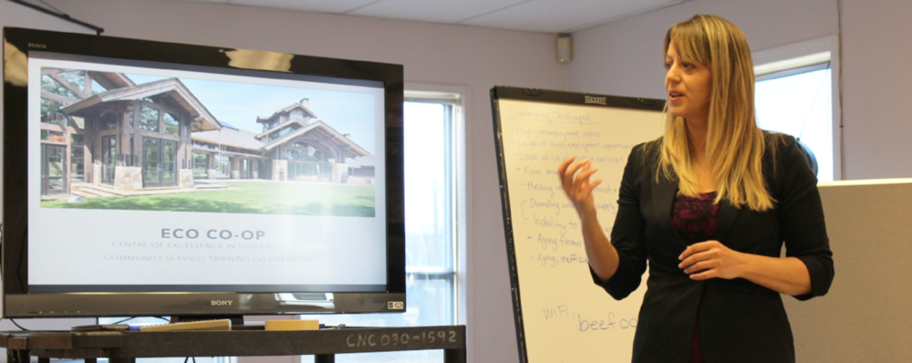 Shellie Gleave presenting to a group of community leaders about the opportunity in Fraser Lake for a unique co-op idea.
