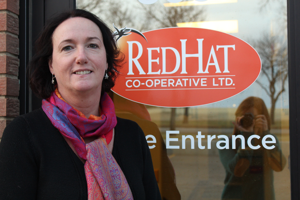 Red Hat Co-operative General Manager, Gillian Digman outside their facility near Redcliff, AB. PHOTO: Aasa Marshall