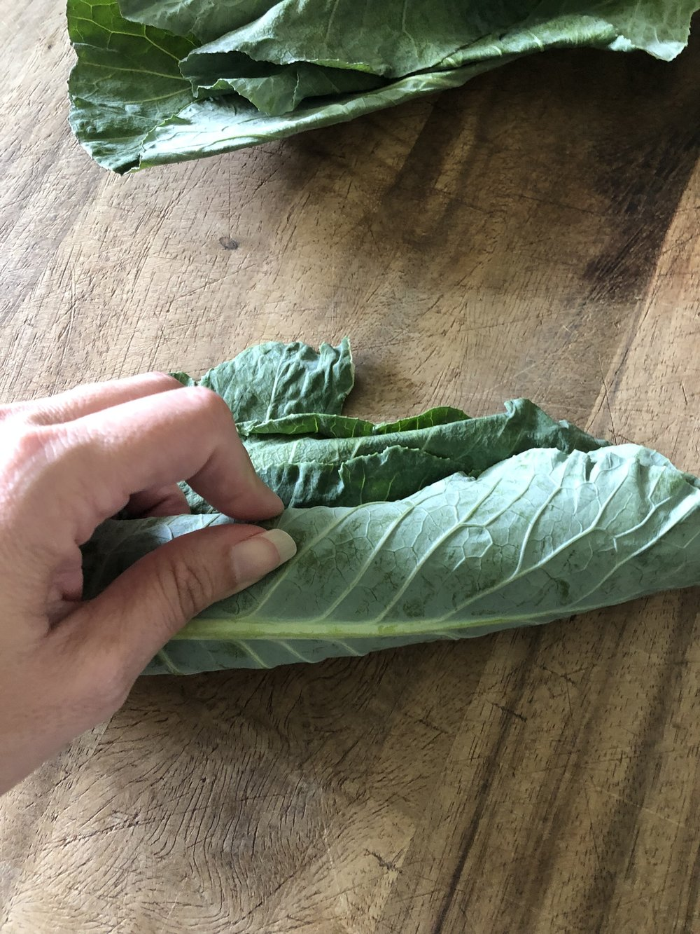 Roll up the leaves to make it easier to cut.