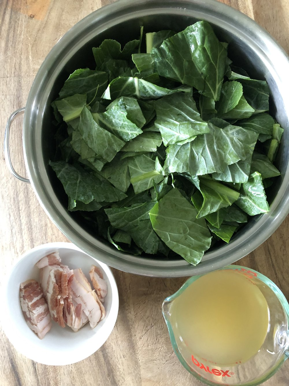 Place Rinsed collard greens in large pot and add in 3 Slices of chopped Bacon and 32 ounces Organic Chicken Broth or better yet...use homemade.
