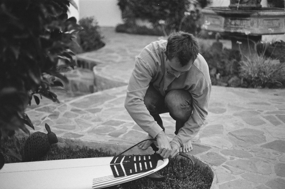 Matty T, getting his 5'11 pintail super soaker ready for a surf.