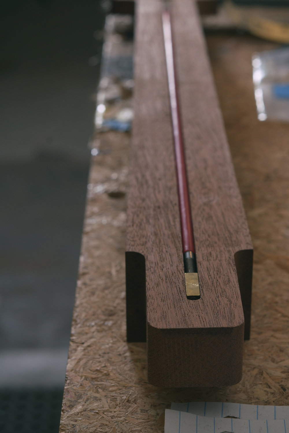 Fitting truss rod before gluing on fretboard.