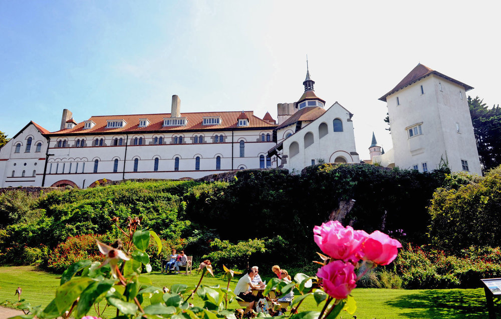 Caldey Abbey and pink roses.jpg