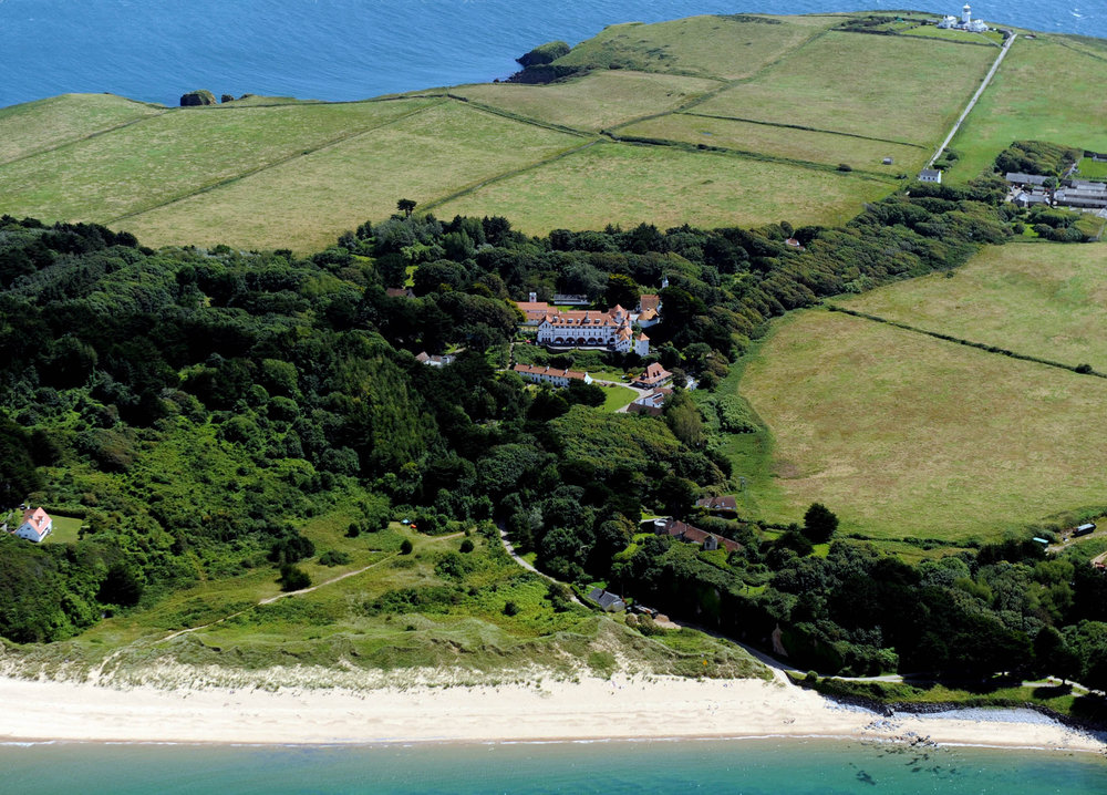 Caldey Abbey and Priory Beach from air.jpg