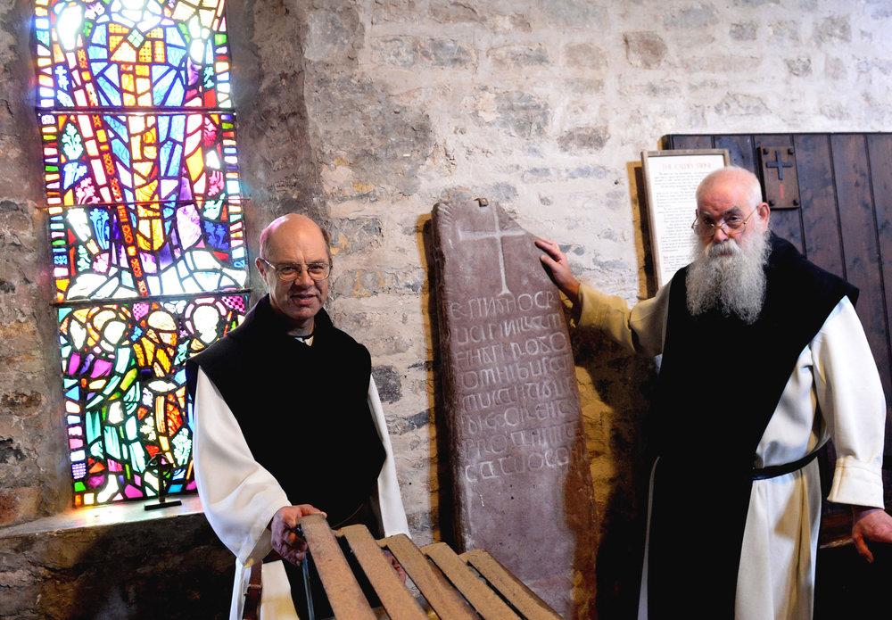 Caldey Ogham stone and monks.jpg