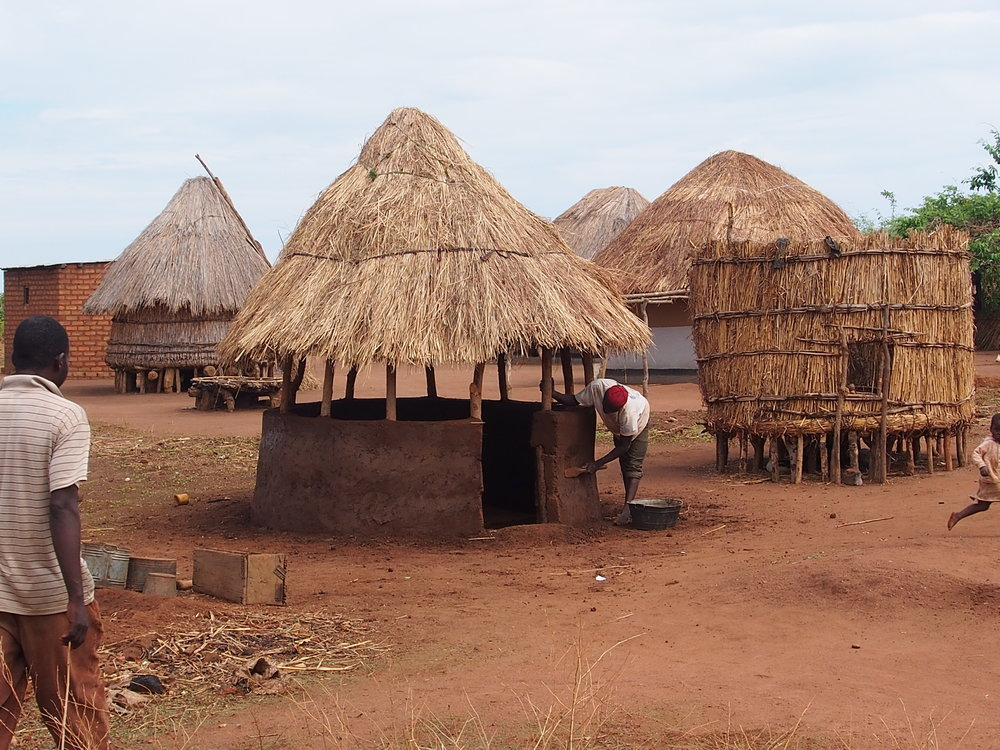 Half-wall kitchens, as seen being built here in the village, in combination with an improved cookstove, are expected to provide significant positive health outcomes for women and children from reduced exposure to smoky open-fires.