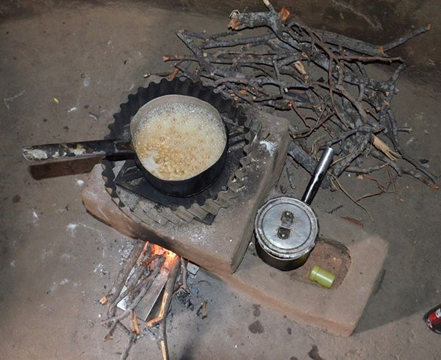 A pot of peanuts simmering on a TLC-CQC rocket stove built in a new half-wall kitchen in Petauke, Eastern Zambia. The stove is so efficient that it needs only a few small sticks to keep it going for hours in a simmering phase. Wood is stored behind the stove to dry from hat radiated from the bricks. In this mode the stove is virtually smokeless, reducing chronic respiratory diseases that follow cooking on open fires. @comaco_zambia @cameron.newcombe #CQuestCapital