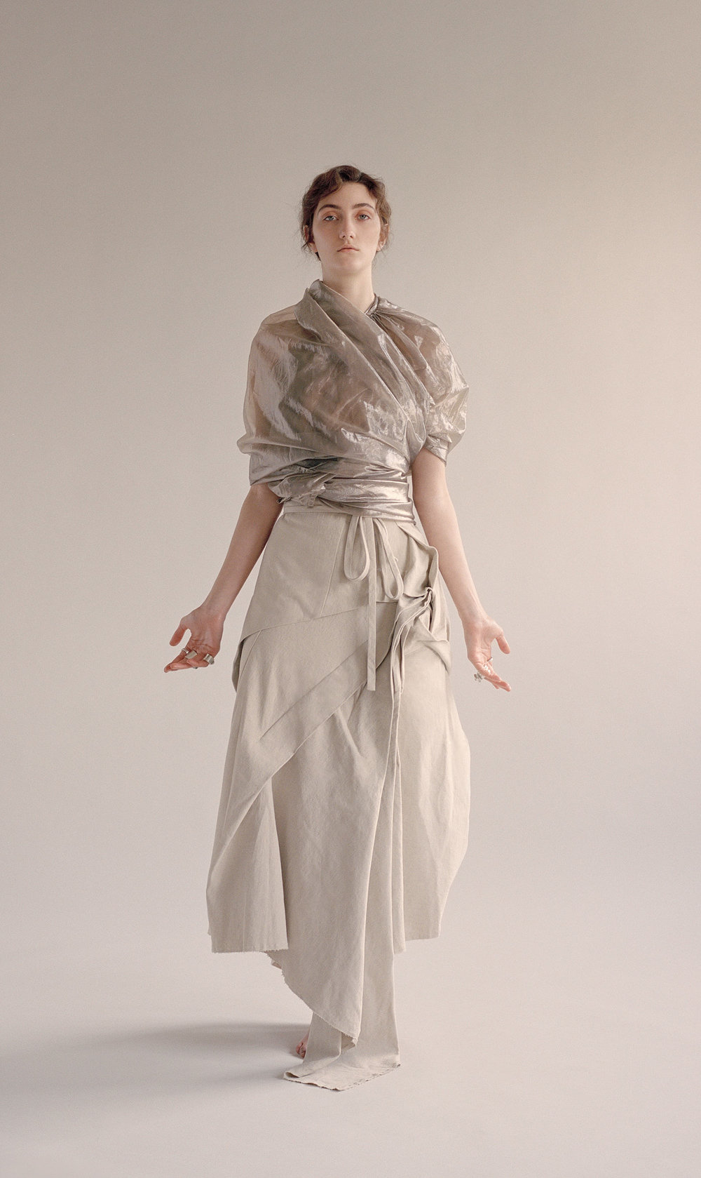 Golden Organza Cape worn as a top from Rellik, Beige Linen Folding Skirt by Renli Su, Silver & Quartz rings by Gala Colivet Dennison