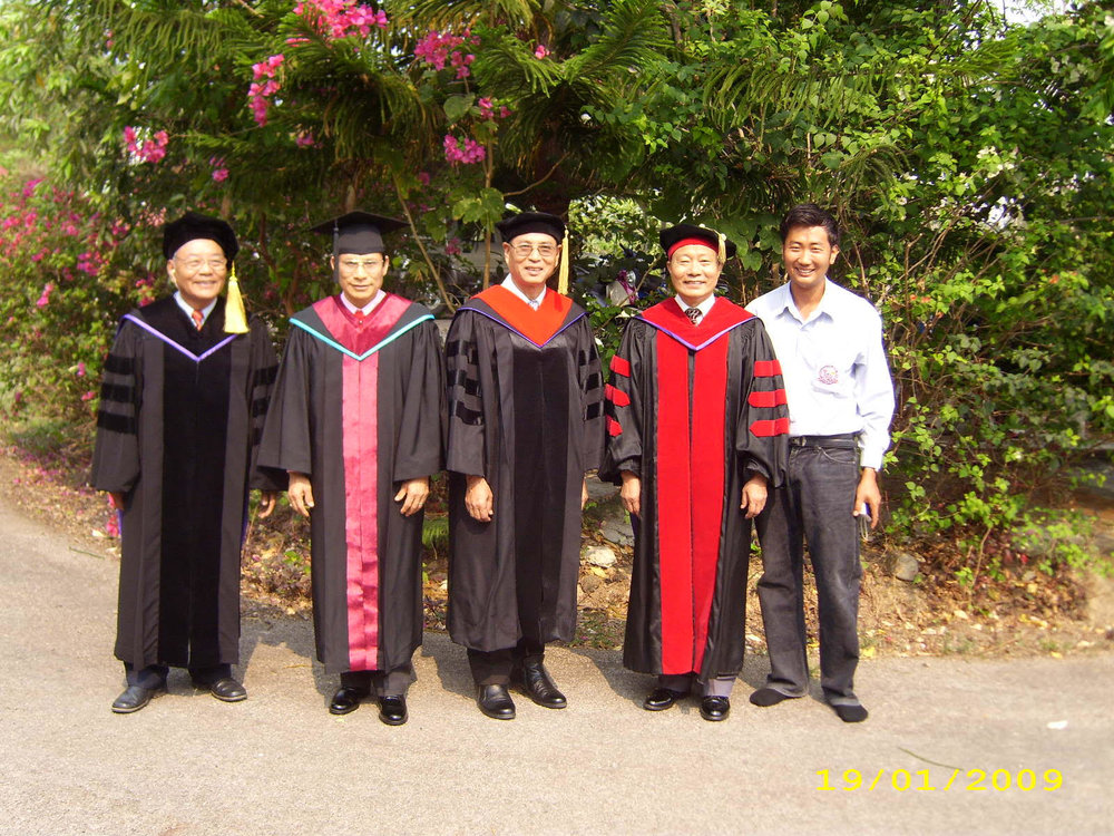 Ahpu (center) with other LBI professors and a student.