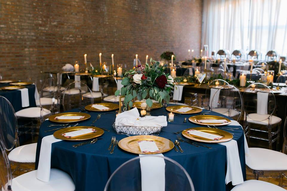 Its fall which means these jade colors will be making a comeback, which does not make us upset at all! How gorgeous are these deep colors paired with the gold chargers? The floral arrangement set the mood and match the venue space perfectly with that warm romantic tone. The large skinny candles one the long tables allow for that same romantic flair, with guests being able to see across the table to their neighbor.