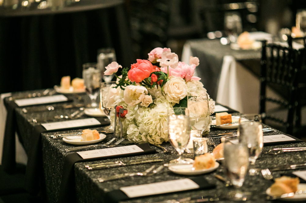 This dark and sparkly tablecloth paired with this light and airy centerpiece comes together for a beautiful combination. Mixing opposites together can cause a different, dramatic look for your wedding.