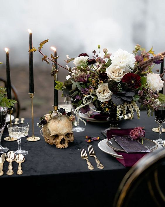 The halloween element can be subtle, like this skeleton head. Super cool and dark, this romantic tablescape looks elegant but has the wow factor your guests will remember!