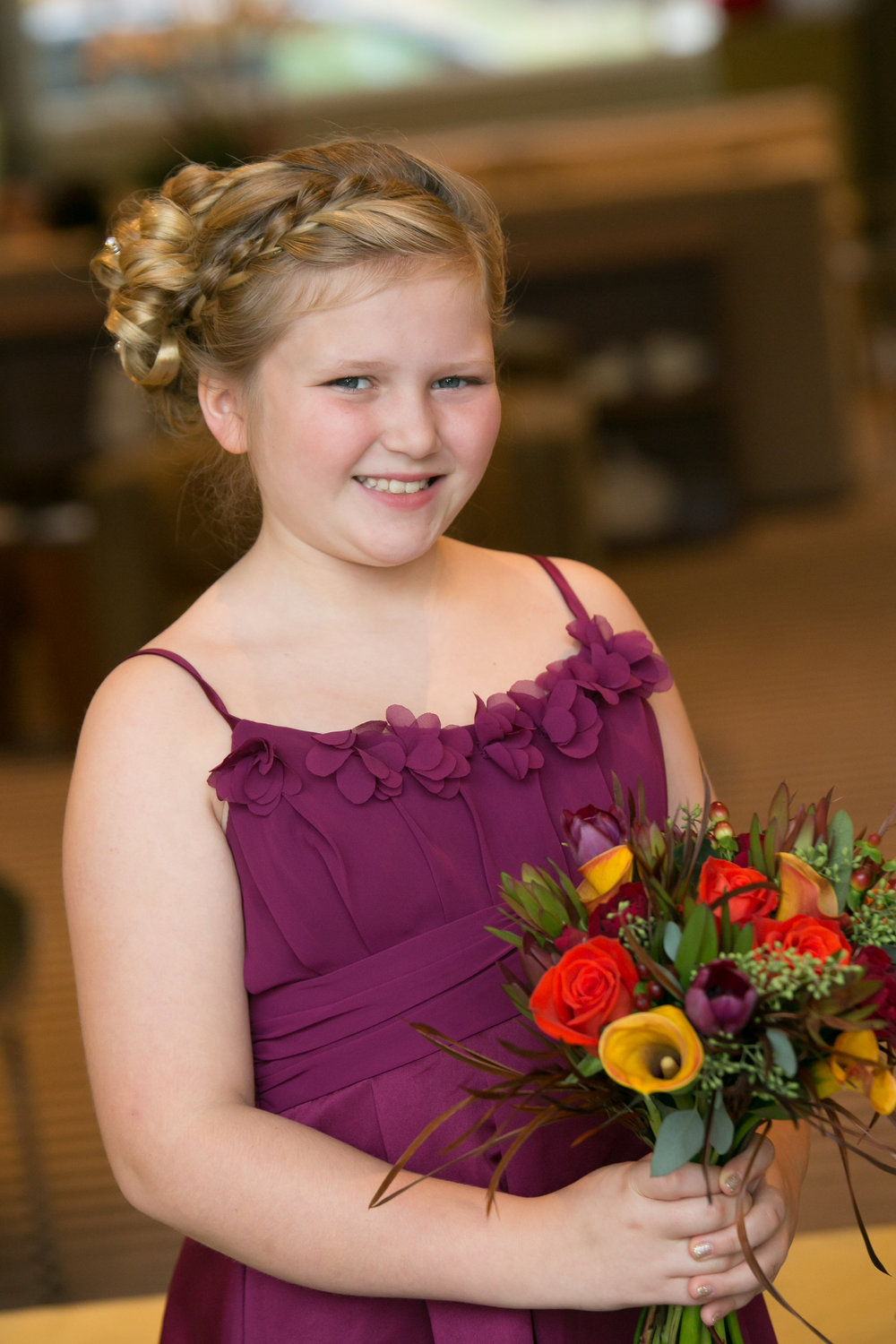 Amy's daughter had her heart set on a purple dress.  We planned all the flowers off of her beautiful plum dress.
