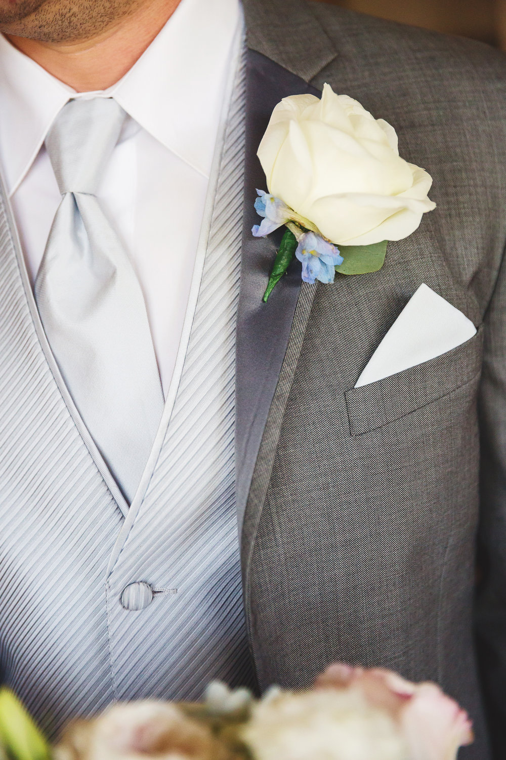 White rose boutonniere Central Illinois Wedding Florist